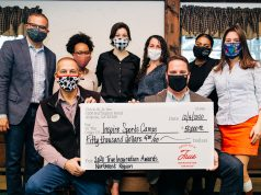 Inspire Sports Camps receives a check from Chick-fil-A